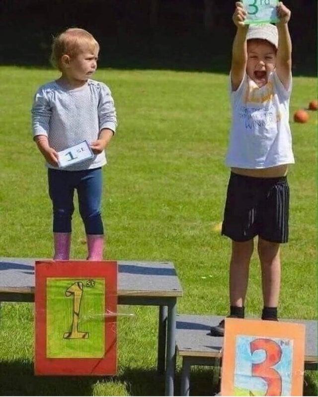 Children celebrating on a race podium.